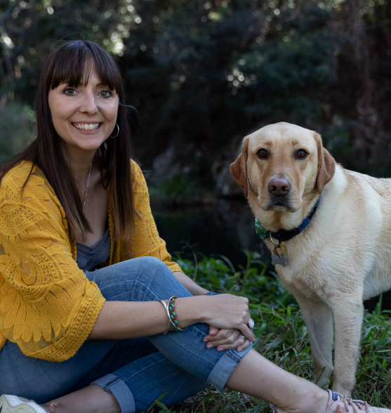 Amanda, the artist who runs Paper Pickle and her pet dog.
