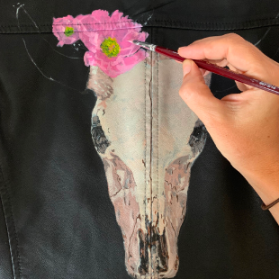 In progress shot of painting onto leather jacket.